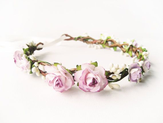 This lovely flower crown features gorgeous handmade mulberry paper blooms scattered over a handwoven headband. Dainty, creamy berries are wound