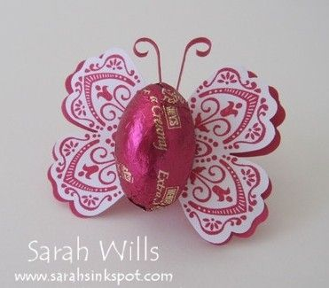 Perfect for Easter treats...a beautiful die cut butterfly holding a chocolate Easter Egg.