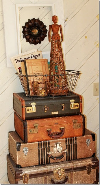 love the vintage suitcases and the cage doll in a rusty basket!
