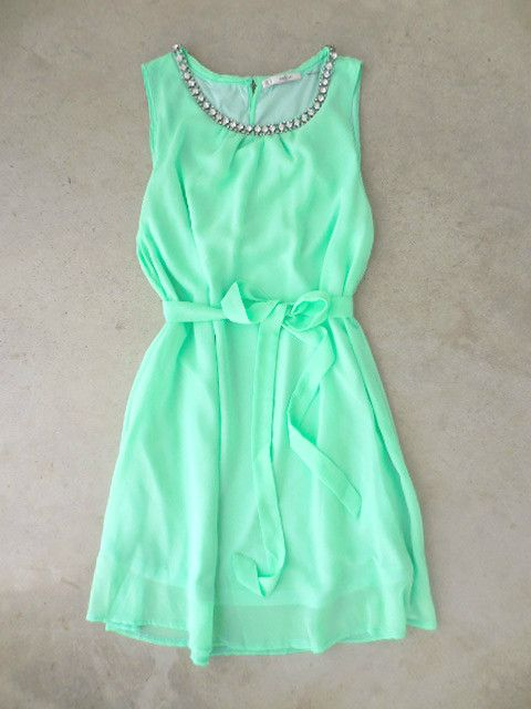 """Enchanting mint dress finished with a sparkling neckline. Slip on dress, keyhole back and fully lined. Finished with a coordinating sash for a feminine silhouette. Polyester. Imported. Length: 35"""""""