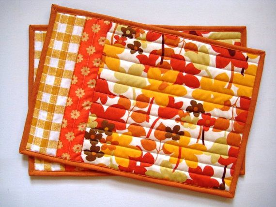 This pair of mug rugs, snack mats, or little placemats couldnt get any cheerier! Theyre all stitched up in bright orange fall prints with a