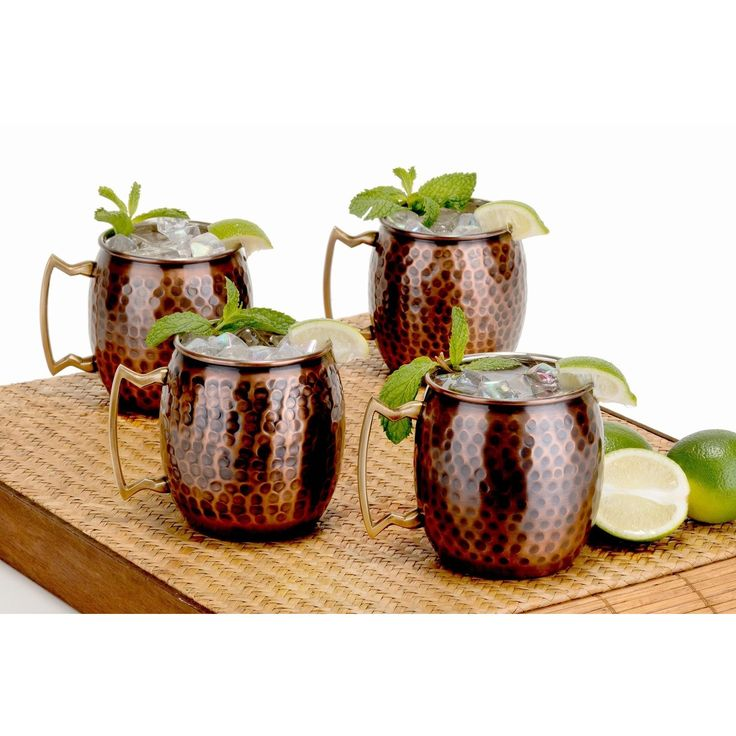 This set of four unique and stylish solid copper mugs include comfortable solid brass handles, making for easy lifting. The mug of choice when serving the famous Moscow Mule, a refreshing cocktail made of ginger beer, vodka and a dash of lime juice.