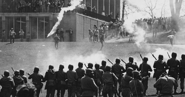 Kent State shootings were shootings of unarmed college students protesting Vietnam War at Kent State University in Kent, Ohio, by members of Ohio National Guard on May 4, 1970, 29 guardsmen fired approximately 67 rounds over period of 13 secs & wounding 9 others. Hundreds of universities, colleges, & high schools closed throughout US due to student strike of 4 million students. Grand jury indicted 8 of guardsmen, but charges were dismissed for lack of evidence.