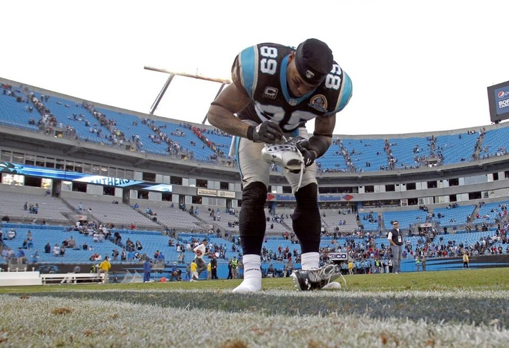 Smithe signs his cleats and leaves them at midfield for the Samaritan's Feet organization 2012 in photos: Steve Smith