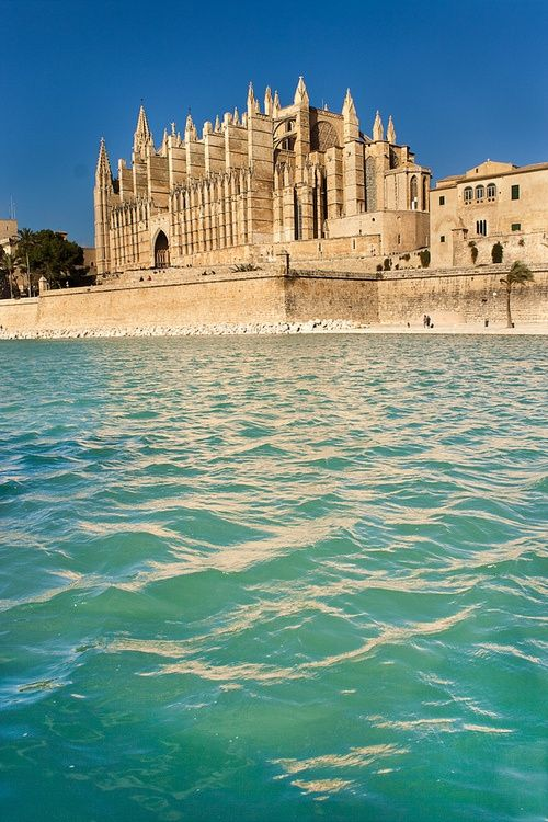 Palma Cathedral - Mallorca, Spain - Day 3 excursion. A gorgeous giant harbor filled with luxury yachts. This church has enormous circular stained glass windows, stunning inside.