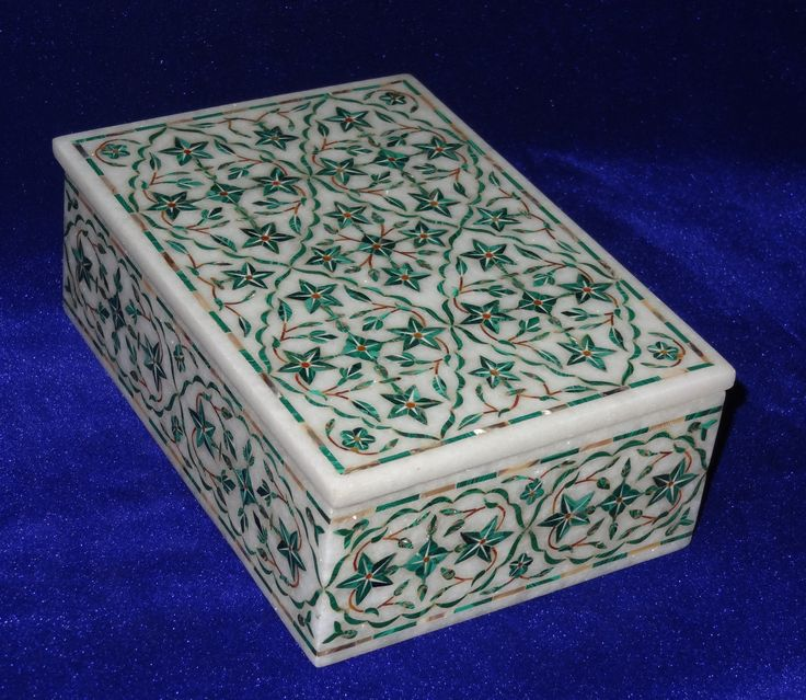 Marble with inlaid malachite and other semiprecious stones. Probably from India.