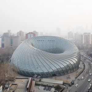 Doughnut-shaped+television+studio+in+Beijing+is+enclosed+in+a+latticed+shell