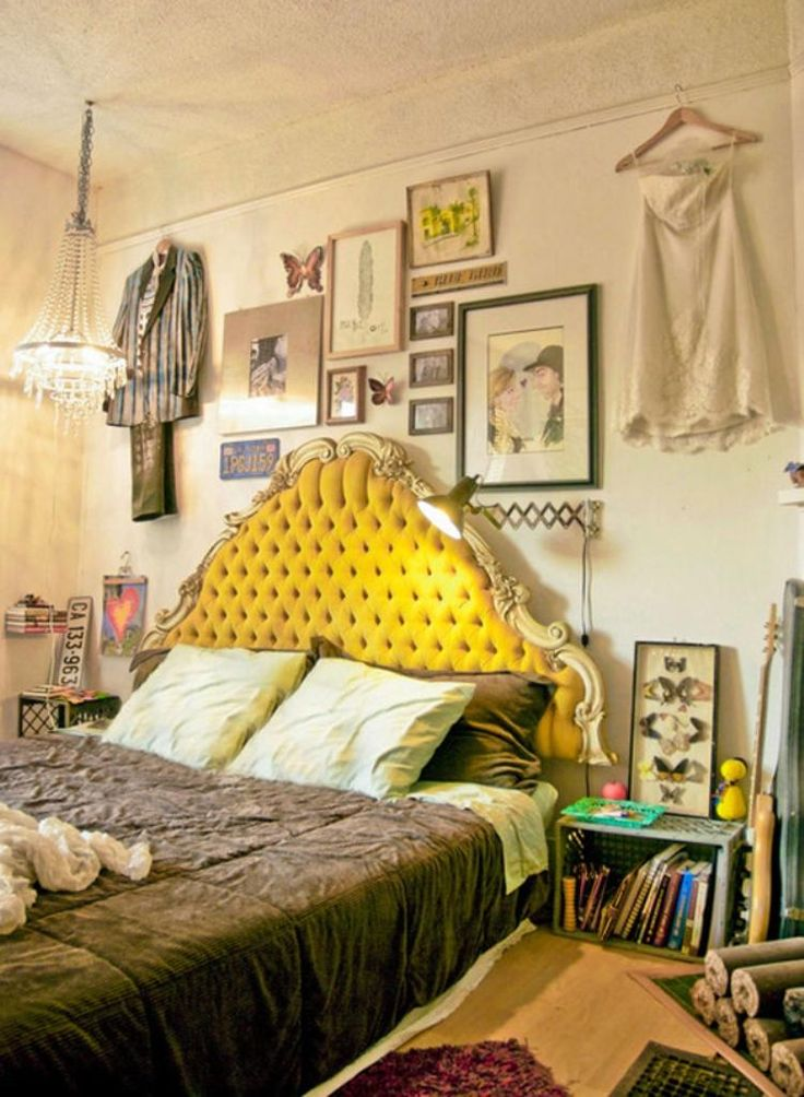 Dig the picture wall and vintage headboard.   20 Whimsical Bohemian Bedroom Ideas - Rilane