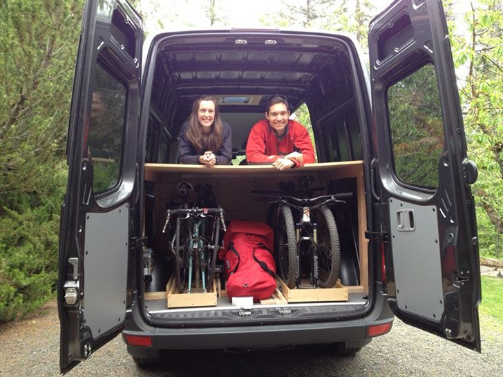 Dakota and Chelsea spent 15 months traveling around the U.S. in this comfortable Sprinter Van with a sliding bike rack for their four bikes.