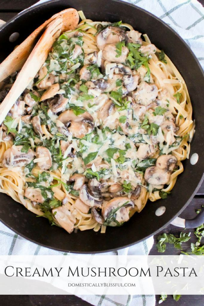 A quick & easy recipe for Creamy Mushroom Pasta with spinach & topped with parmesan cheese & fresh parsley. | creamy mushroom fettuccini | creamy pasta | creamy fettuccini | vegetarian | quick recipe | easy dinner recipe | mushroom recipe | pasta recipe | Italian recipe | Italian dinner | fettuccini recipe | cream sauce | mushroom cream sauce | mushroom sauce | spinach recipe | mushroom spinach sauce | mushroom spinach pasta | spinach cream sauce #vegetariandinnerrecipesitalian