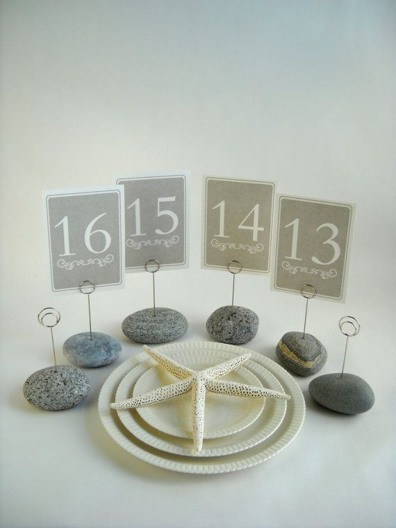 beach wedding ideas using maine beach stone wedding table number holders in shades of gray