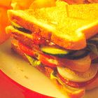 Clubsandwich met bacon en tomaat