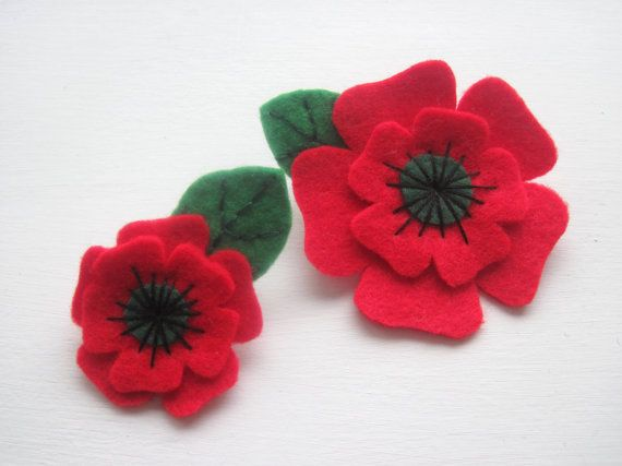 This beautiful Remembrance Poppy Brooch is made from two layers of thick red wool blend felt with a dark green felt center and black embroidered stamen and comes with an embroidered green leaf. This poppy has been hand cut & sewn specifically with Remembrance Day in mind, but would