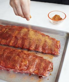 The rub will impart flavor to the ribs while they slowly cook. Make sure you work it into all areas of the meat with your hands.