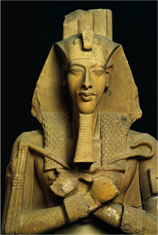 Statue of Akhenaten, known for abandoning traditional Egyptian polytheism and introducing worship centered on the Aten, which is sometimes described as monotheistic or henotheistic. He was also a father of Tutankhamun. 1353–1336 BCE
