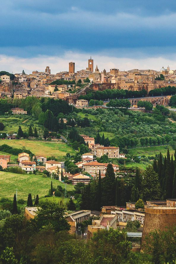 The Orvieto city in southwestern Umbria, Italy. The city scape is among the most dramatic in Europe, rising above the almost-vertical faces of tuff cliffs that are completed by defensive walls built of the same stone called Tufa.