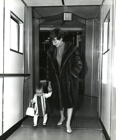Julie Andrews with daughter Emma Watson coming through the tunnel after de- boarding from an aircraft dressed for Air Travel as we all were back then !
