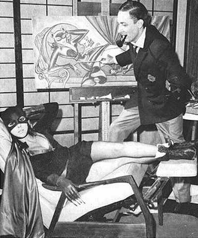 Bob Kane with a Catwoman model. Because this is how all comics artists work -- with navy blazer and pipe, and a beautiful model lounging in their luxurious studios.