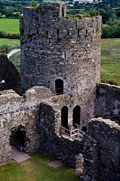 Kidwelly Castle, Wales, built in 1200 and was the location for the film Monty Python and the Holy Grail, appearing in the very first scene after the titles