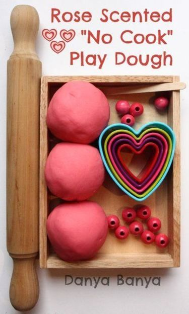 Rose scented no cook play dough with beads and heart shaped cutters. Perfect sensory play for Valentines Day, or any day!