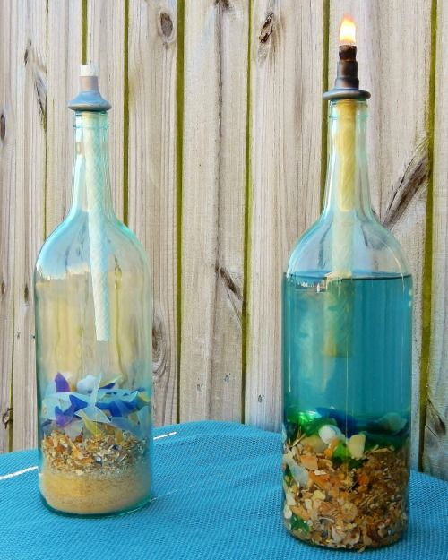 Wine Bottle Tiki Torch Oil Lamps with a Beach Theme: http://www.completely-coastal.com/2016/05/wine-bottle-tiki-torch-oil-lamps-nautical-beach-theme.html