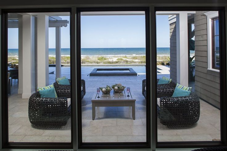 Amanda Webster Design: Transitional Coastal Color Interior Design / Photo: Neil Rashba / Outdoor Patio, mesh chairs