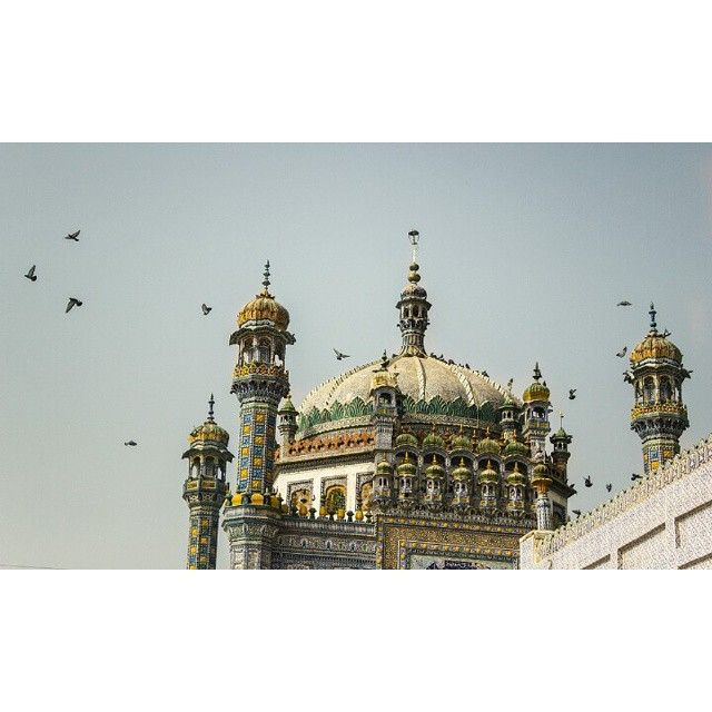 The enchanting beauty of Sachal Sarmast's #shrine  Abdul Wahab, fondly known by his disciples as Sachal Sarmast, (intoxicated man of god and truth) was born in 1739 in a village called Daraza in #Khairpur. He spread the message of #divine #love through his #poetry, which embodied the principles of #mysticism and according to him was 'divine' inspiration.  Photo: @shameenkbrohi / Dawn  #pakistan #poet #architecture #dawndotcom