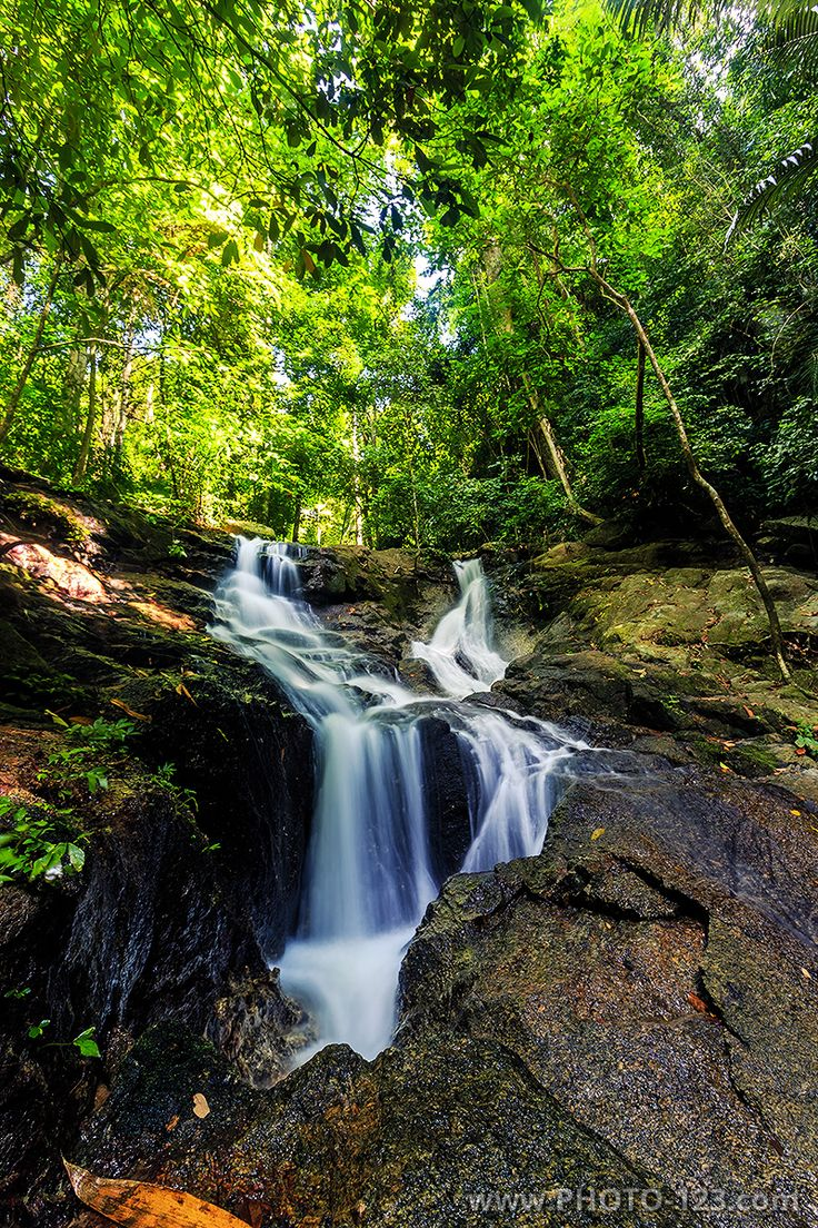 Kathu waterfall in a tropical forest at sunny day. Phuket