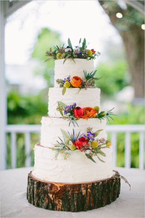 Rustic summer wedding cake with a log slice cake stand