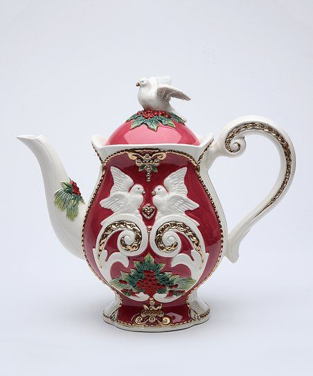 Complete your holiday table setting with this intricately painted ceramic teapot that features a dove perched on its lid.