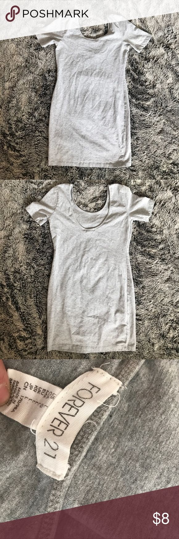 Plain grey Bodycon Dress This is a staple altering piece for fall! It has a plunging back, super cute! Simple and in excellent used condition, no major flaws. Forever 21 Dresses Mini