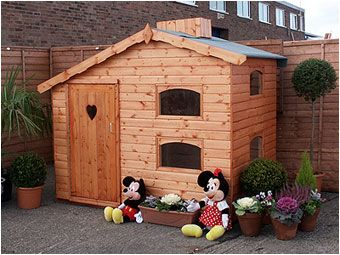The Snow White is a pretty little cottage style playhouse, 7x5ft, and extending up to 5ft7 in height. Available to order form Adrian Hall Garden Centres, Feltham