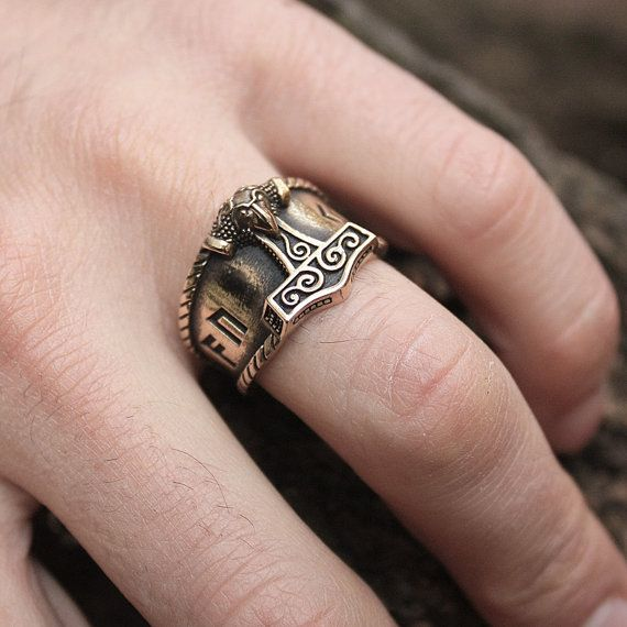 This is a real solid bronze 3-dimentional hand-crafted antique finish adjustable size ring . The bronze ring is a mini replica of a real Thor hammer found during excavations in 1877 in Skåne, Sweden. The four runes on the ring are Ansuz, Uruz, Jera, Ansuz.    Runes that are used in combinations carry own unique meanings or spells. The four runes used in this sequence: Ansuz, Uruz, Jera, Ansuz create a widely used word auja which means happiness, luck. The magic word auja brings good luck to…