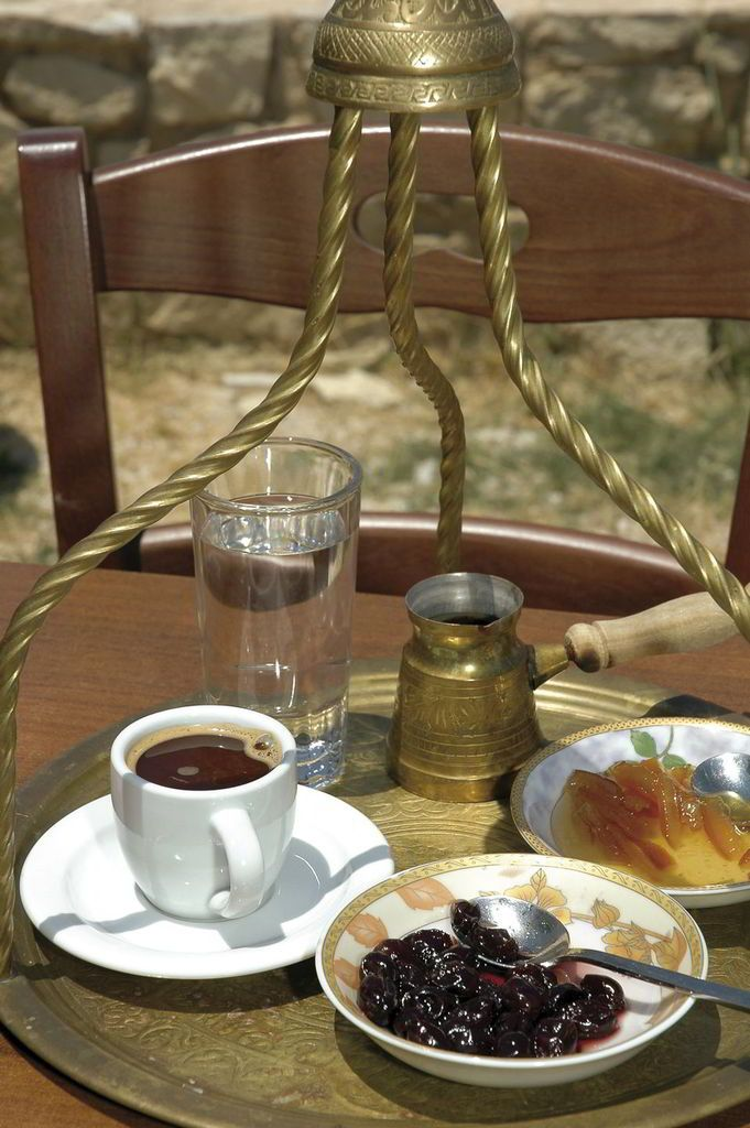 """A greek coffee is always a pleasure served in local traditional """"cafeneio"""", as it is always accompanied by sweets and home – made delicacies."""