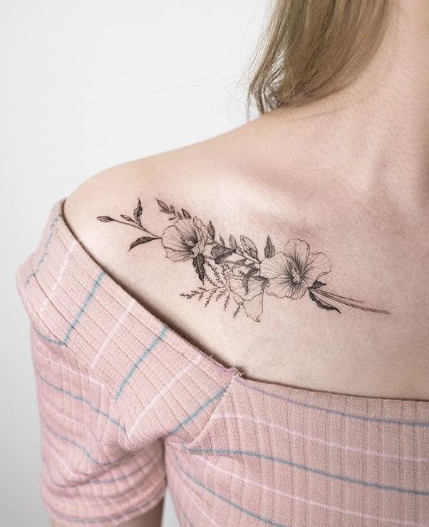 Black flower bouquet tattoo along the collar bone. #flower #tattoo