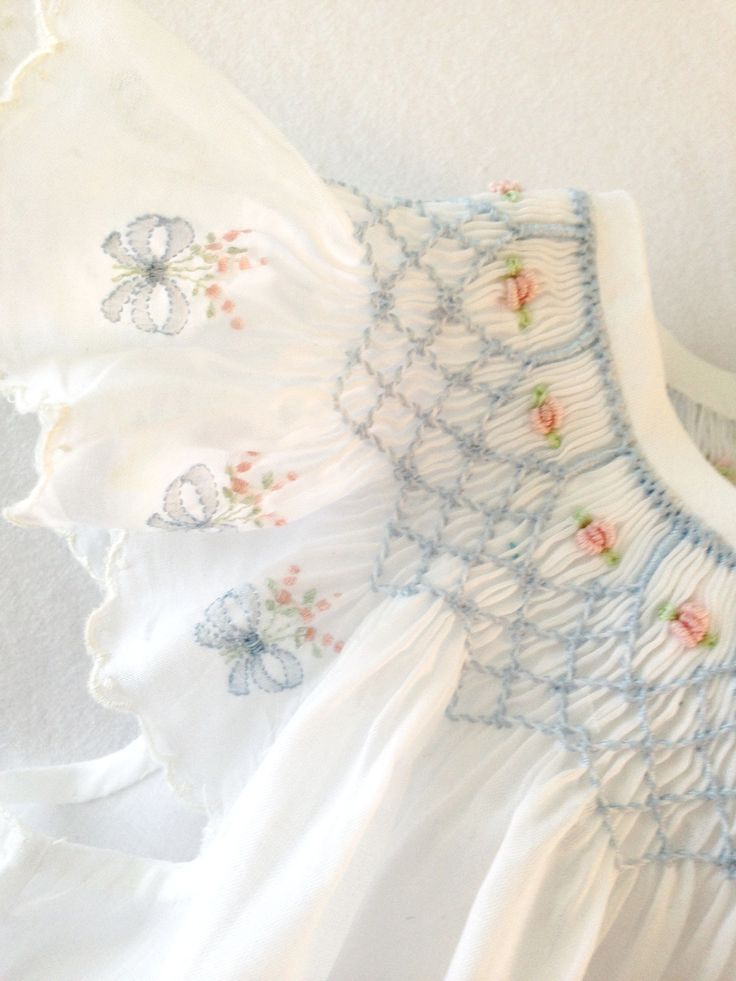 """Swiss batiste Angel Sleeve Bishop using embroidered Swiss edging as sleeves. Smocking plate is """"Elegant and Easy"""" by Julia Golson, and pattern is """"Bishops and Bonnets"""" by Chery Williams."""
