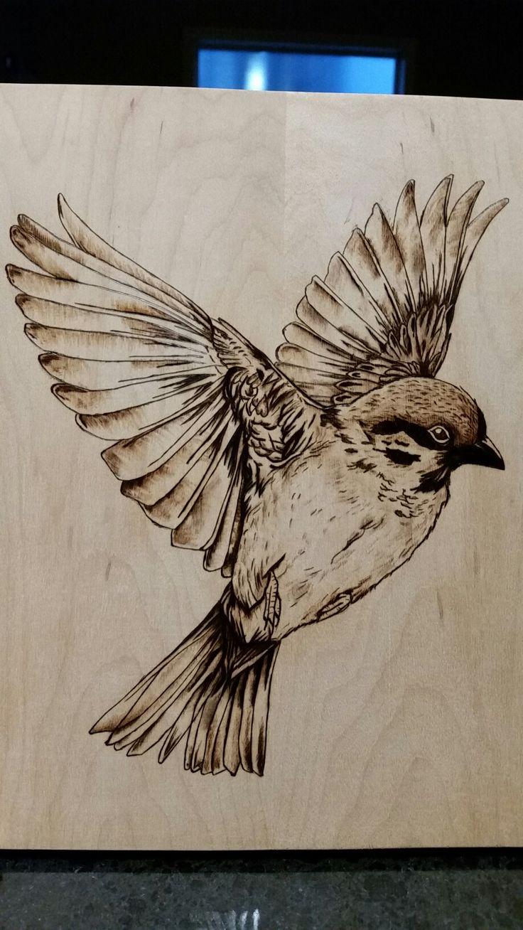 Wood burning Pyrography bird in flight