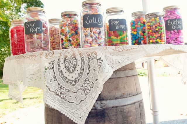 Whiskey Barrel Candy Table Credit: Story Board Wedding