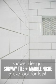Getting a luxe look for less! See how we used an elongated subway tile with marble hex tile niche in our bathroom makeover.
