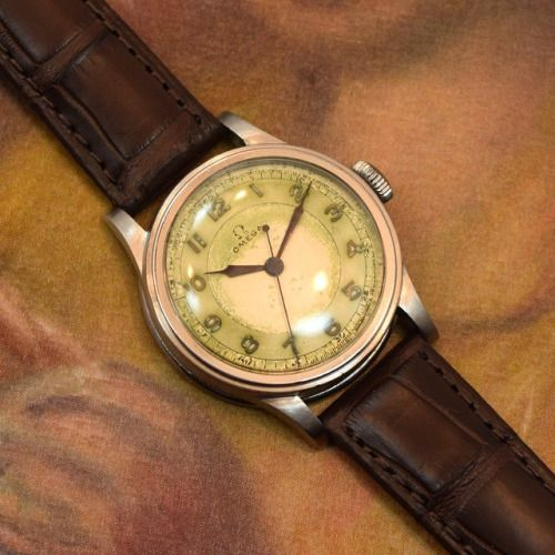 A very early-WWII era Omega Military watch from 1938 with a heavily patinated, silver dial and applied arabic numerals. Absolutely stunning! (Store Inventory # 9823, listed at $1750). (at Second Time Around Watch Company - Vintage Watches)