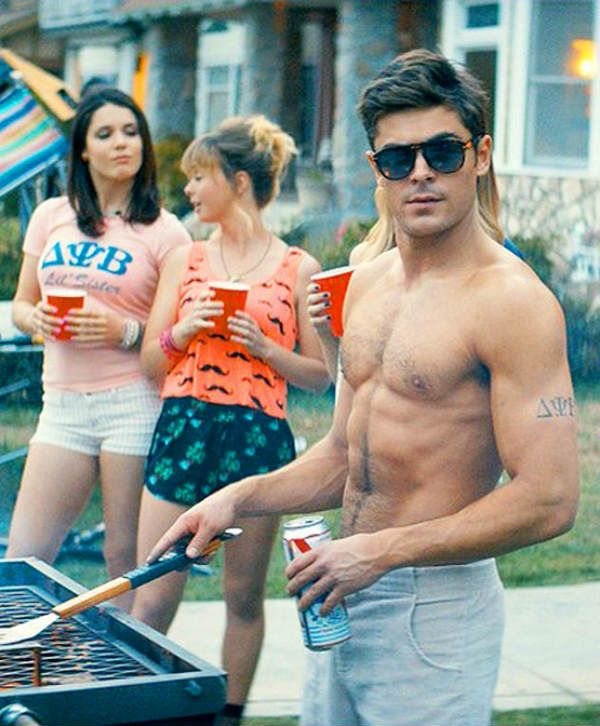 25-years-old Zac Efron the former High School Musical star goes shirtless and shows off his chiseled body and perfect pecs for his upcoming movie Neighbors.