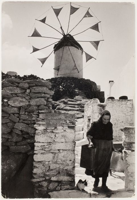 Old lady and cat beneath windmill, Mikonos, Greece] 1951. Copyright © David Seymour/Magnum Photos