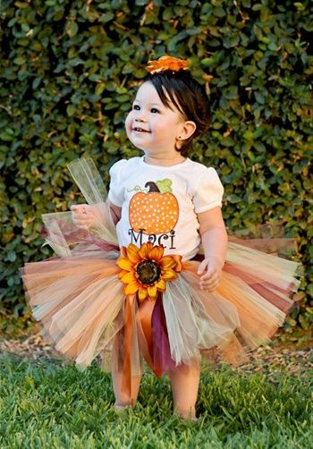 "Little Miss Princess Tutu:  Tutu features large fall flower, orange satin ribbon bow, shades of burgundy, chocolate, mint, butter, and orange tulle, and 9"" length. Customized tulle colors available; various flower type and colors available.    Fabric: Tulle  Color: Various colors"