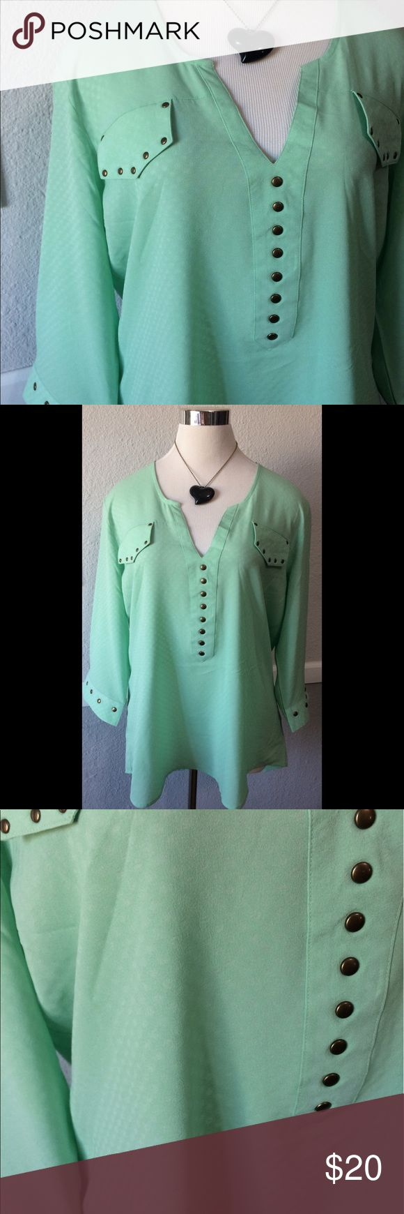 Unique Mint Blouse With Brass Details Large Like new. Semi sheer. Subtle Polka Dot. Non functional pockets (only flaps). Marked XL. Might be juniors as it fits woman's Large rock 47 Tops Blouses