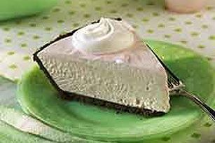 Cream cheese, marshmallow creme, whipped topping and sherbet are combined for a lighter-than-air filling, then frozen in a chocolate cookie crust.
