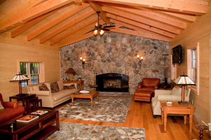 Living Room Wood Beams Amp Stone Wall Log Homes Inside