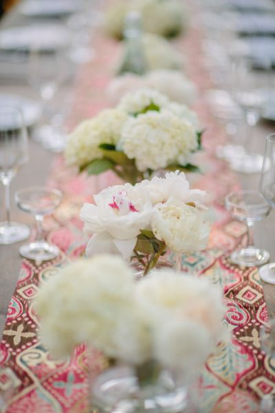 a standout mix of white #peonies and printed fabric runners #centerpiece Photography by joielala.com, Florals by http://www.plentyofpetals.com  Read more - http://www.stylemepretty.com/2013/09/25/california-bohemian-backyard-wedding-from-joielala/