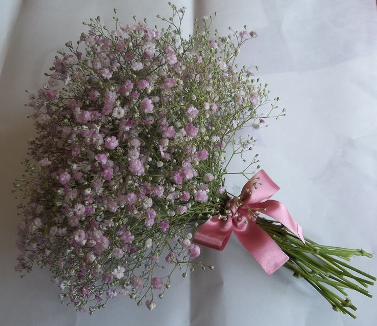 Bridesmaid bouquet made from pink gypsohilla tied with a simple dusky pink bow.