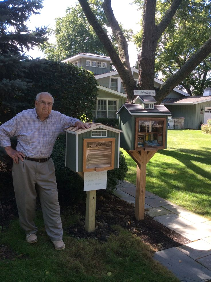 "Cathy Walsh. Hinsdale, IL. My Little Free Library was getting too full and disorganized. So I asked my father, Joseph Dolack, to build me a ""children's addition."" Both are replicas of my house in the background. Aren't they cool?"