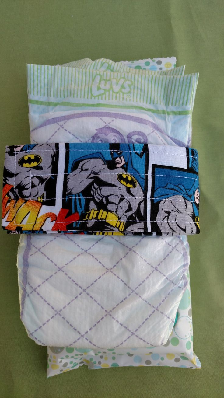 Batman Comic Strip Baby Diaper Holder Strap Great for Diaper Bag Organization by EllieAnnes on Etsy https://www.etsy.com/listing/252952386/batman-comic-strip-baby-diaper-holder